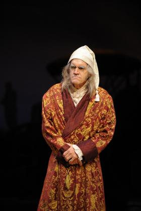 Chris Kayser as Ebenezer Scrooge