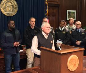 Flanked by Atlanta Mayor Kasim Reed (left) and agency heads, Gov. Nathan Deal responds to criticism over the storm response.