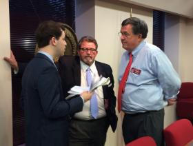 HB 875 sponsor Rick Jasperse (right) with public safety committee chair and bill co-sponsor Alan Powell (center).