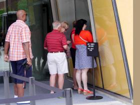 Visitors line up to purchase tickets for the newly-opened center.