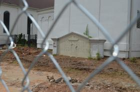 Construction workers prepare Friendship Baptist Church for demolition.
