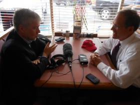 Rep. Jack Kingston (right), a Republican U.S. Senate candidate, talks with WABE's Denis O'Hayer at the White House restaurant in Buckhead during a campaign stop on July 18, 2014.