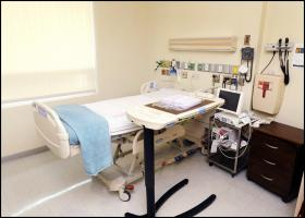 The isolation room at Emory University Hospital looks the same as any other hospital room from the inside.