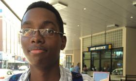 Kaleb Anderson, a junior at B.E.S.T Academy in Southwest Atlanta, takes in a movie at Atlantic Station. He says what limited sex education is offered at his school doesn't involve LGBT-related issues.