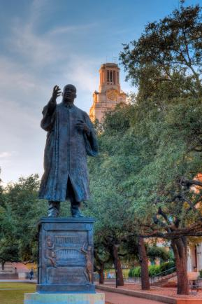 Bronze sculpture of Dr. King on the campus of the University of Texas at Austin.  The statue portrays Dr. King in his doctoral robes.