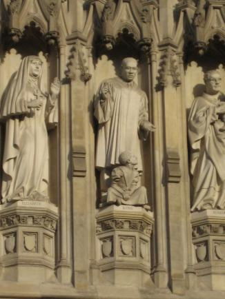 Martin Luther King, Jr., statue on the wall of Westminster Abbey, where he is recognized as a 20th Century Christian martyr.