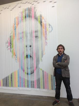 "Nathan Sharratt with his self-portrait, ""Bathroom Selfie In Sugar and Spice and Also Ants"" at the Atlanta Contemporary Art Center"