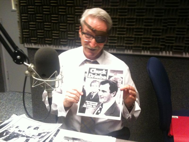 Boyd with a photo of Chuck Driebe