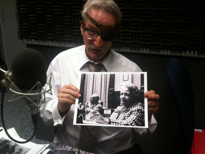 Boyd Lewis holding photo of Rosa Parks