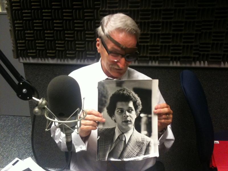 Lewis with a photo of Julian Bond