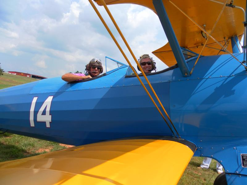 Pilot Harry Balance and host John Lemley get ready for a ride in a Stearman biplane.