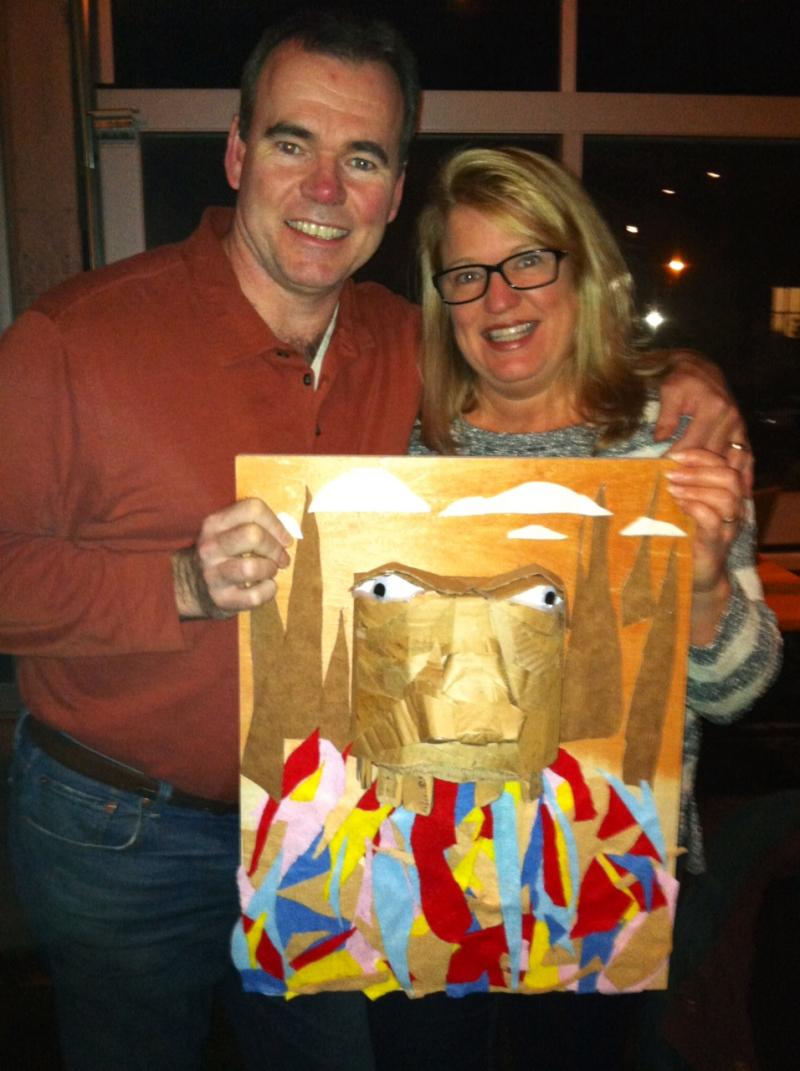 Dan and Alicia Thompson, with one of three pieces of art they purchased in Atlanta's first art CSA
