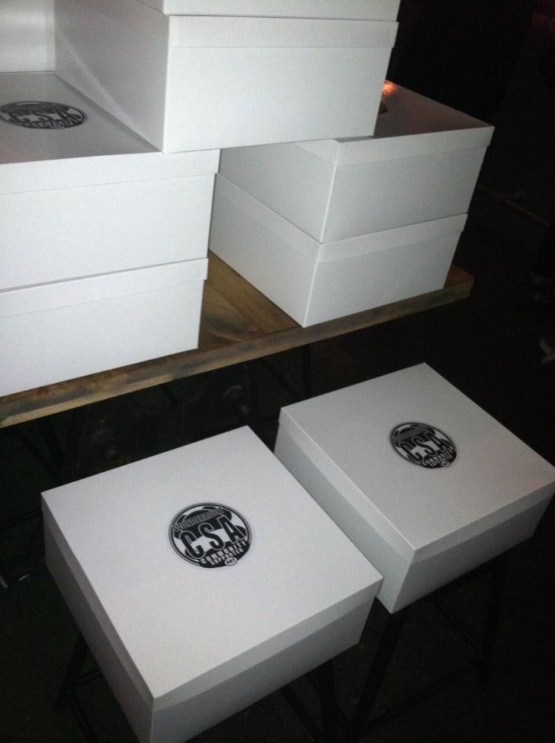 Boxes containing the first harvest from Wonderroot's art CSA
