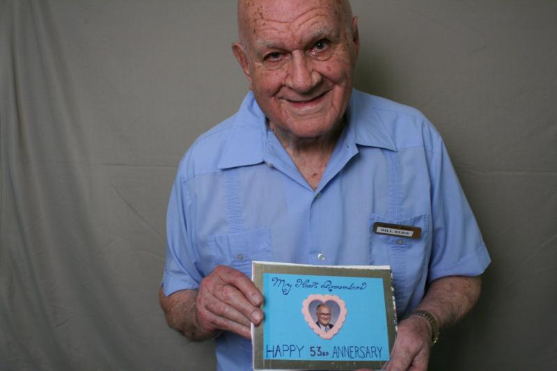 Bill Kuen, holding a card he made for his wife