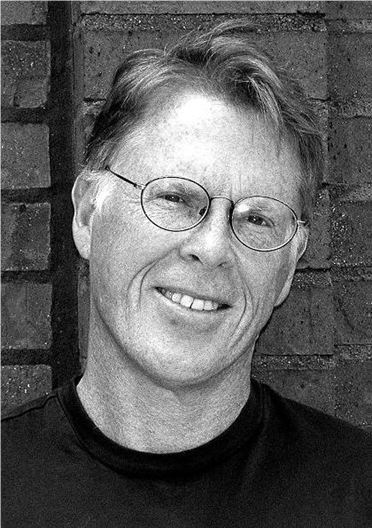 Charles McNair reads from 'Pickett's Charge' at the Cyclorama Thursday, April 10.