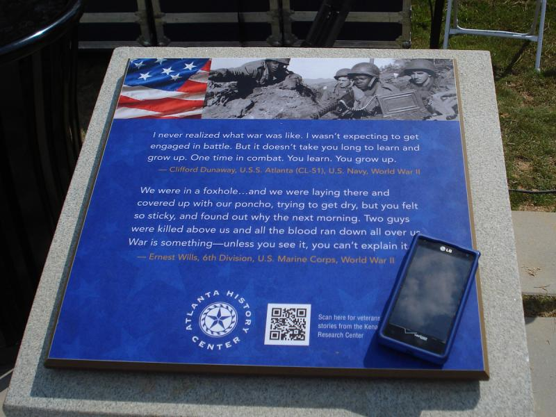 Each of several panels around the park has a QR code. Any smartphone can scan it to access videos of veterans' stories.