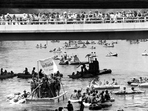 Thousands of spectators watched the race from the river's banks and bridges.