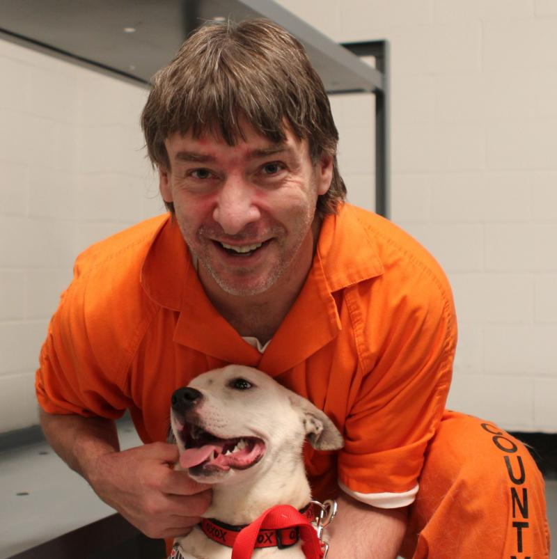 Fulton County Jail inmate John Mari with Daphne, his Canine Cellmate