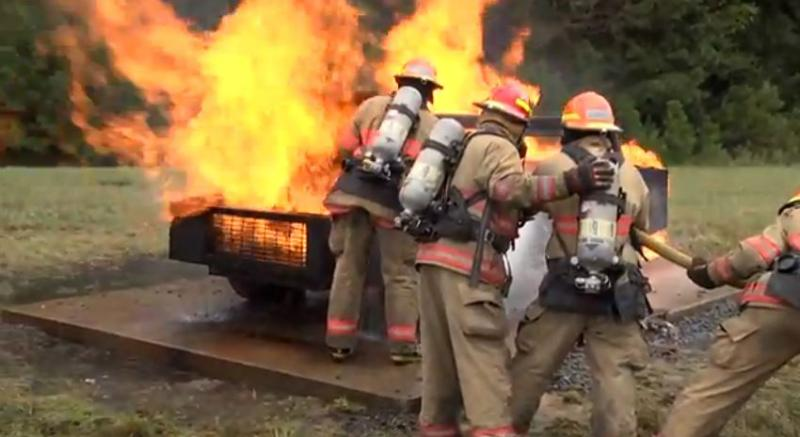 Prospective Cobb County firefighters learning how to put out a vehicle fire.