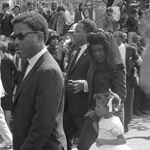 Bernice King walk alongside her mother Coretta at her father's funeral.