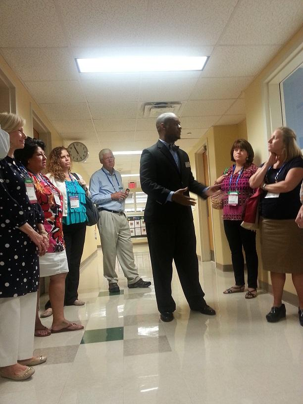 Educare Atlanta director, Steve White, leads a tour of lawmakers inside Educare Atlanta.