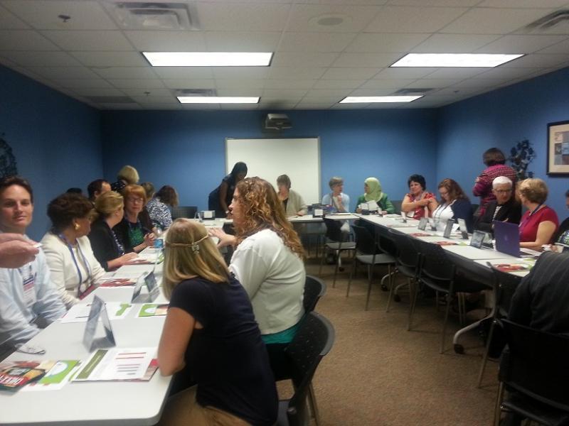 Lawmakers gather around a table inside Educare Atlanta.