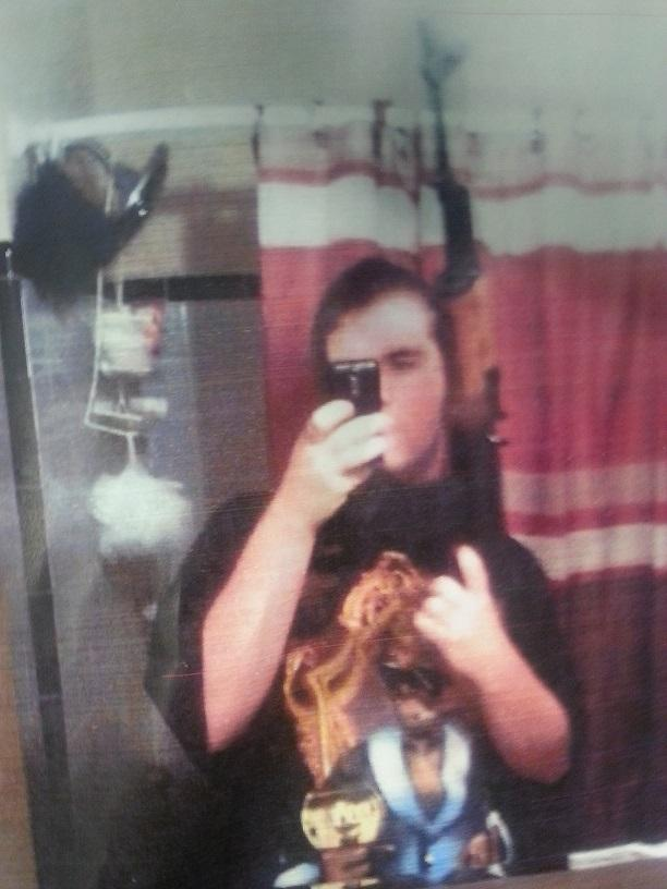 Police released this self-portrait of suspect Michael Brandon Hill and some of his guns, taken with his cellphone.