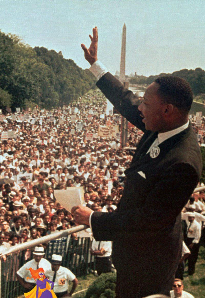 Dr. Martin Luther King, Jr., waves to the crowd from the Lincoln Memorial.
