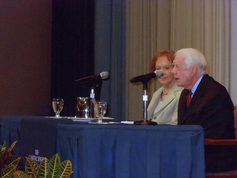 President and Mrs. Carter speak during a discussion held at the Carter Center Tuesday evening.