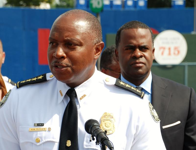 Atlanta's police Chief George N. Turner (shown with Atlanta Mayor Kasim Reed) is joining the executive board of a national law enforcement organization.