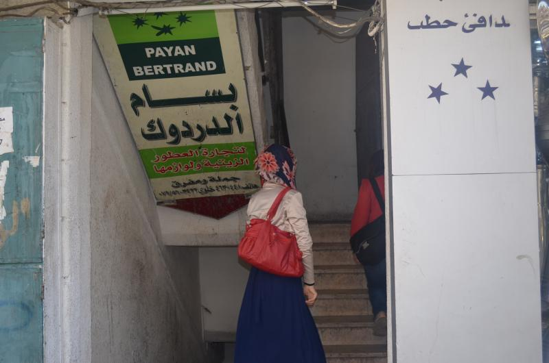 To reach Maryam, CARE officials climb four flights of stairs to her 4 room flat.