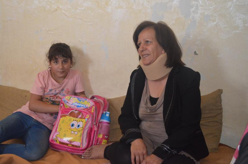 Maryam and her nine-year old daughter Nour. It had been two years since Nour was in school. She's now learning to read and write.