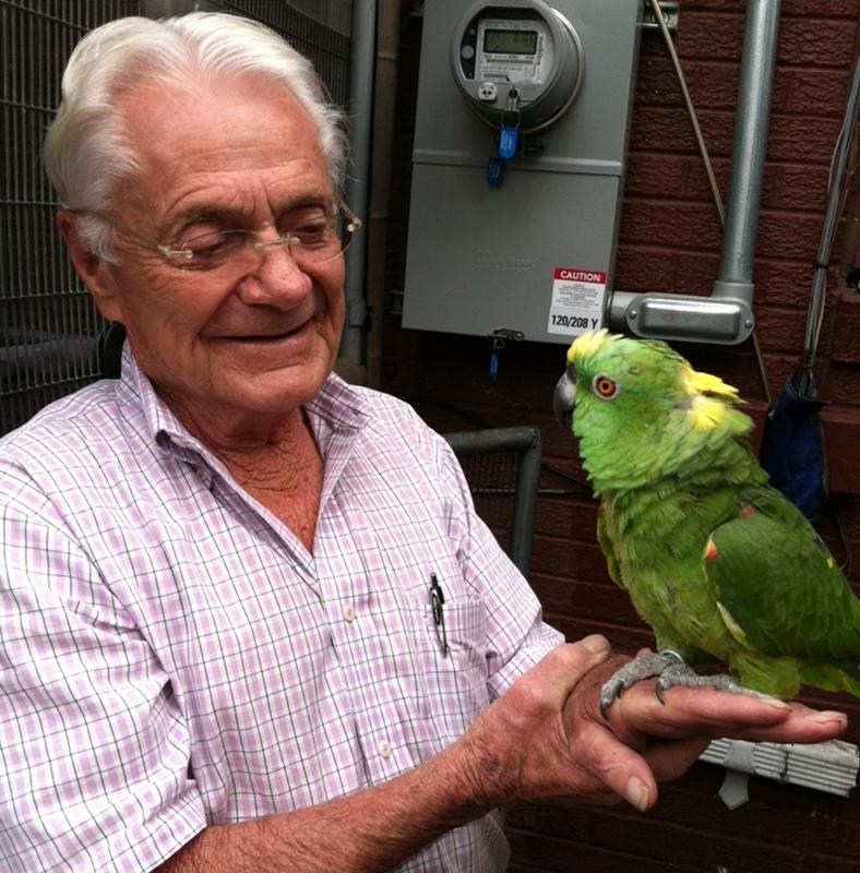 R. Thomas and his bird, Sparkle