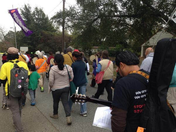 Protesters marched two miles from the courthouse to the detention center.
