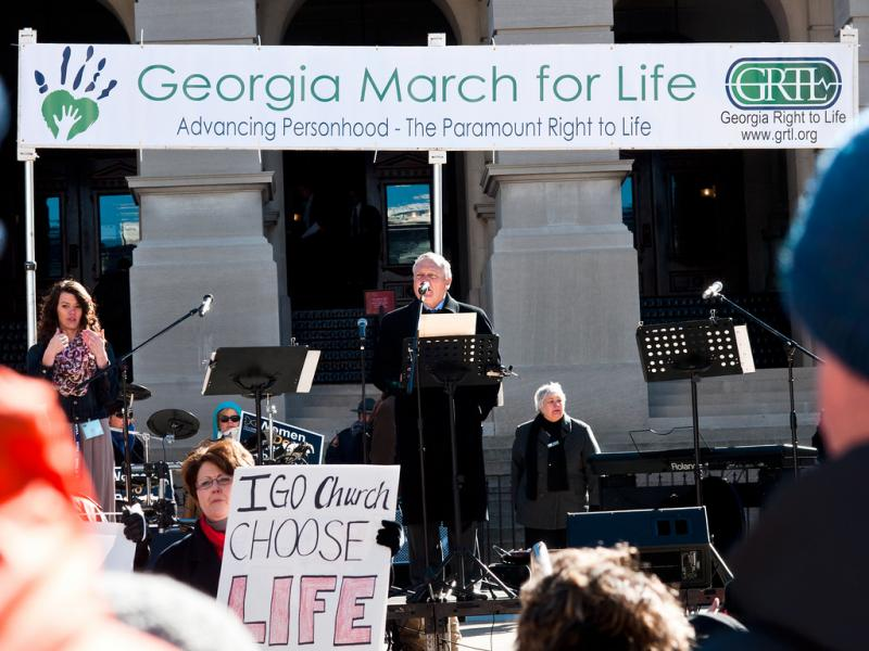 Gov. Deal, speaking beneath a sign for Georgia March for Life today at the State Capitol.