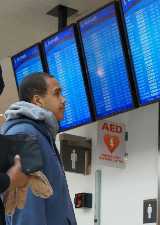 A passenger looks at the flight board at Hartsfield-Jackson International Airport
