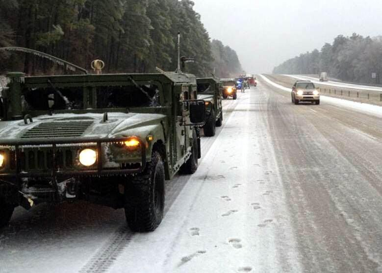 Airmen of the Savannah-based Georgia Air National Guard's 165th Air Support Operations Squadron assist motorists along Interstate 20.