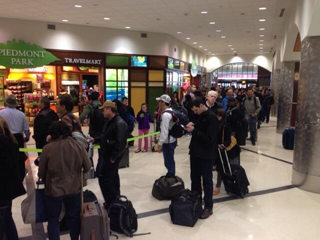 Long lines at the main security checkpoint at Hartsfield-Jackson Atlanta International Airport on Thursday, Feb. 13.