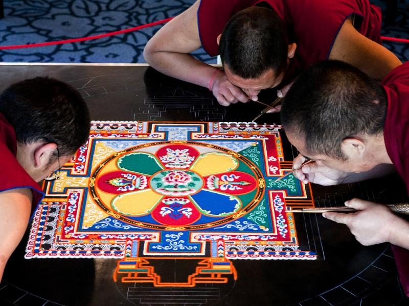Monks working on the mandala during Emory University's Tibet Week