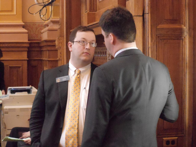Sen. Josh McKoon, R-Columbus, confers with House Majority Leader Ronnie Chance, R-Tyrone, during this morning's Senate session.