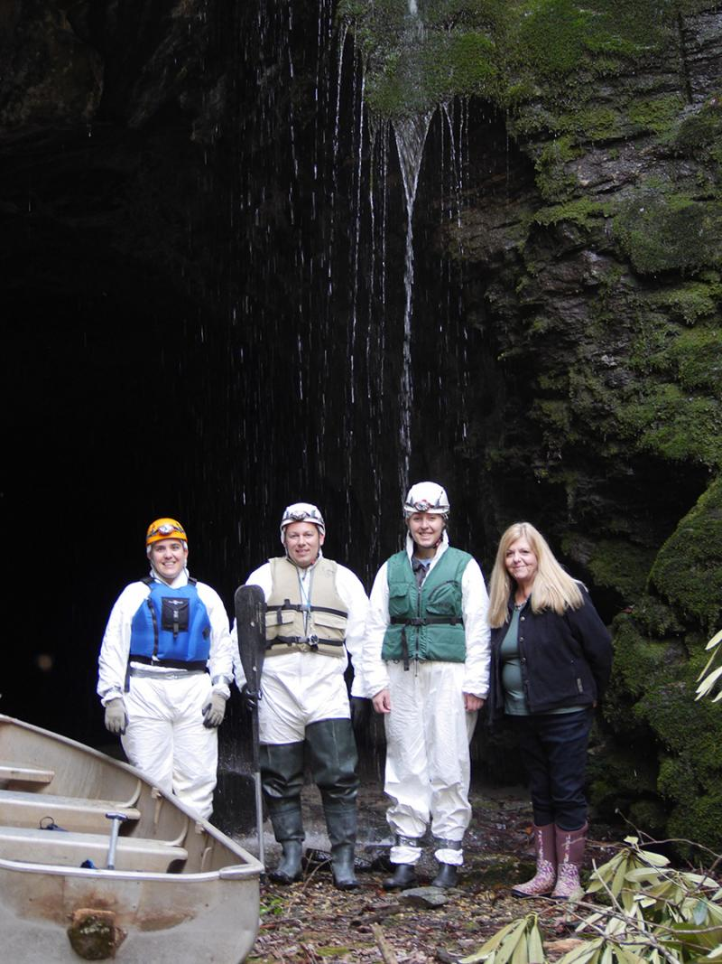 Katrina Morris of the Georgia Department of Natural Resources, left; Pete Pattavina of U.S. Fish and Wildlife; WABE reporter Michell Eloy and property owner Regina Bleckley stand in front of Black Diamond Tunnel.