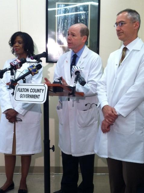 Dr. Patrice Harris, Dr. Matthew McKenna and Dr. Daniel VanderEnde (l to r) discuss the TB outbreak in Fulton County.