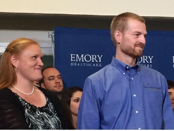 Dr. Kent Brantly stands with his wife at a press conference at Emory University Hospital Thursday. Brantly says he is going away for a while to reconnect with his family.