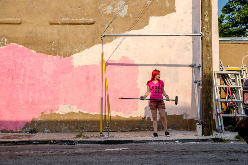 Artist Caroline Caldwell, in front of her mural-in-progress on Edgewood and Hilliard Avenue in Atlanta's Old Fourth Ward