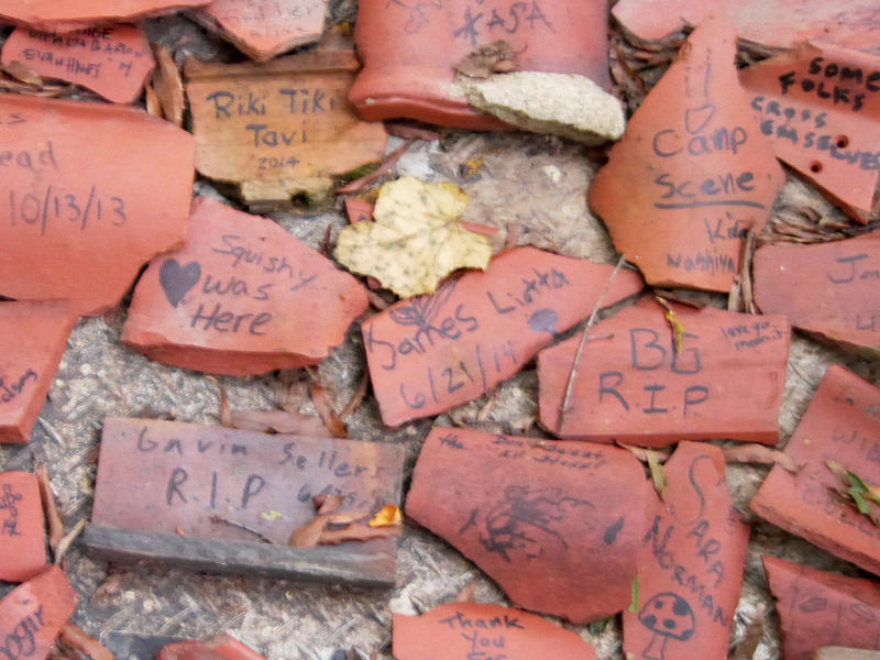 Visitors to the trail add their own messages to pieces of clay tile found around the park.