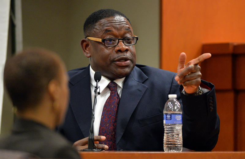 Kelvin Walton, director of Purchasing and Contracting for DeKalb County, identifies suspended Dekalb County CEO Burrell Ellis as he testifies in court Tuesday afternoon.