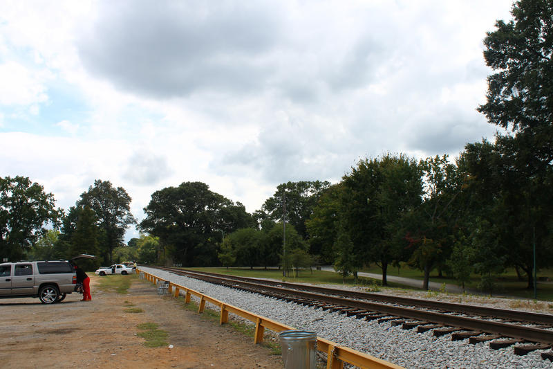 The makeshift parking area by the railroad tracks at Maddox Park