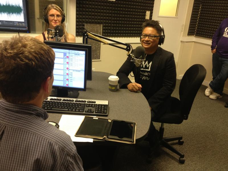 Director Andrea James and Alec Mapa speaking to WABE's John Lemley