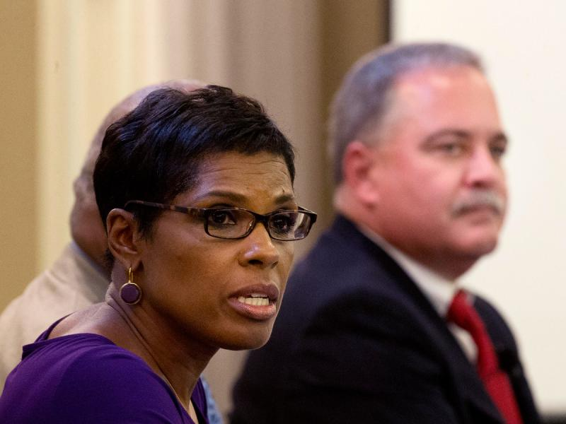 Democratic candidate for State School Superintendent Valarie Wilson speaks as her Republican opponent Richard Woods looks on at right, during a forum sponsored by the state's largest association of teachers Monday, Sept. 15, 2014, in Atlanta.
