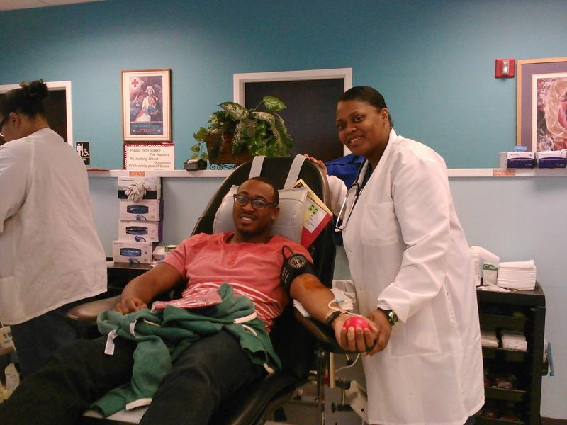Halona Barber draws blood from Justin Brown at the Red Cross blood donation center in midtown.
